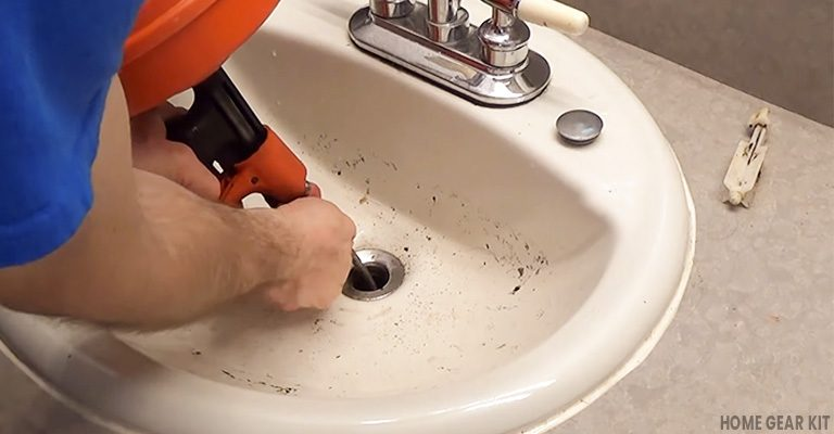 FI of unclog a bathroom sink drain with or without chemicals